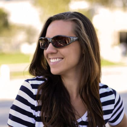 Woman wears steel vistana polarized fit over sunglasses over her prescription eyeglasses.