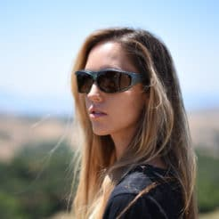 Jory Paul in polarized steel fitover sunglasses with copper lenses for maximum contrast.
