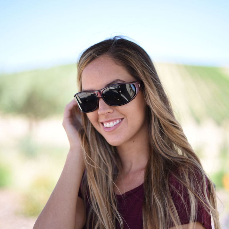 d7d963a49c3 Jory Paul wears burgundy Vistana fit over sunglasses with gray polarized  lenses to shield her eyes