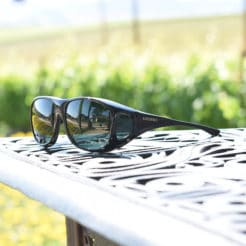 cocoons fitover sunglasses sitting on table