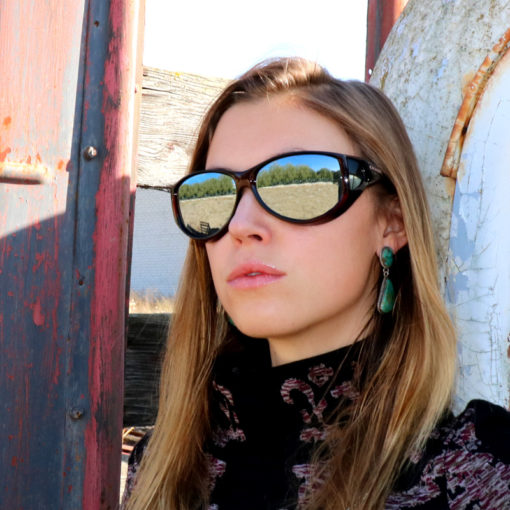 Breeana shields her eyes agains solar damage with Cocoons silver mirror polarized sunglasses